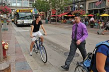 bicyclist in downtown Minneapolis traffic