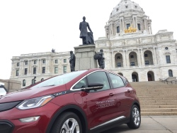 U of M Chevy Bolt parked in front of the Minnesota State Capitol building