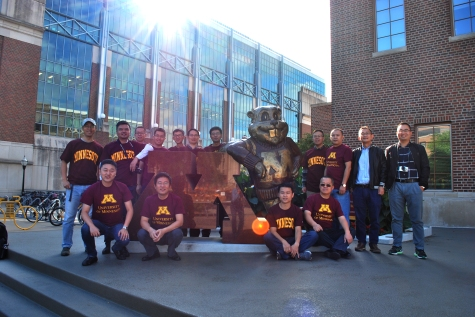 Visiting professionals pose with Goldy Gopher on a U of M campus tour